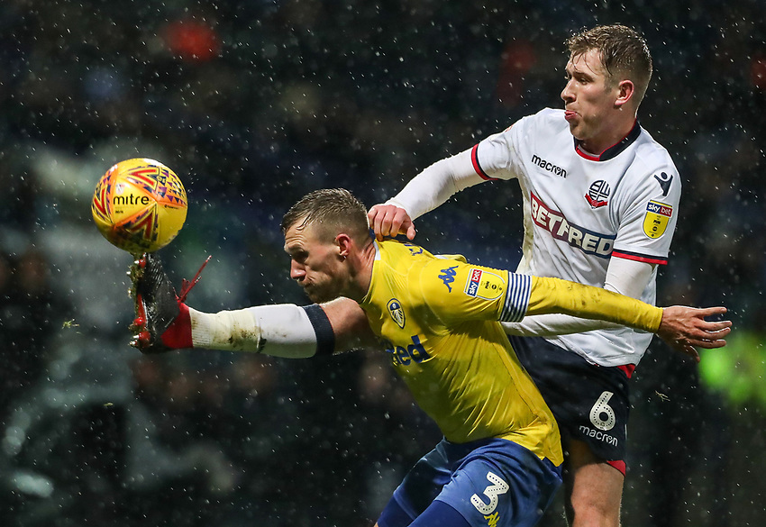 Bolton Wanderers' Josh Vela competing with Leeds United's Barry Douglas<br /> <br /> Photographer Andrew Kearns/CameraSport<br /> <br /> The EFL Sky Bet Championship - Bolton Wanderers v Leeds United - Saturday 15th December 2018 - University of Bolton Stadium - Bolton<br /> <br /> World Copyright © 2018 CameraSport. All rights reserved. 43 Linden Ave. Countesthorpe. Leicester. England. LE8 5PG - Tel: +44 (0) 116 277 4147 - admin@camerasport.com - www.camerasport.com
