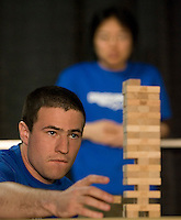 Photo by Stephen Brashear.Noah Callaway of Seattle competes in the fifth round of the Omegathon which feature Jenga during the final day Penny Arcade Exposition at the Washington State Visitor and Convention Center in Seattle, Wash., Sunday Aug. 31, 2008. In the background is Thomas Chan of Chicago.