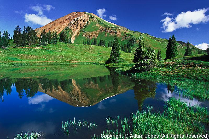 Mountain reflection in alpine pond, Gunnison National Forest, Colorado
