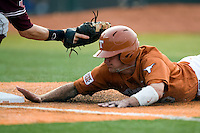 Texas Longhorns shortstop Brandon Loy #10 dives back to first against the Texas A&M Aggies in NCAA Big XII Conference baseball on May 21, 2011 at Disch Falk Field in Austin, Texas. (Photo by Andrew Woolley / Four Seam Images)
