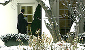 Washington, DC - January 27, 2009 -- United States President Barak Obama mistakes a window for the door of the Oval Office after returning to the White House after meeting with House and Senate Republicans on Tuesday, January 27, 2009. .Credit: Dennis Brack - Pool via CNP
