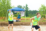Players give it their all at the 2013 Habitat Mud Volleyball Fundraiser on Sunday, June 23, 2013 at Arysley Town Center in Charlotte, NC.