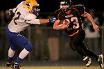 HOWARD, SD - NOVEMBER 8:  Luke Loudenburg #23 from Howard slips past Alex Pulscher #42 from Alcester Hudson for an 89 yard touchdown in the first half of their Class 9A Semifinal game Saturday night in Howard. (Photo by Dave Eggen/Inertia)