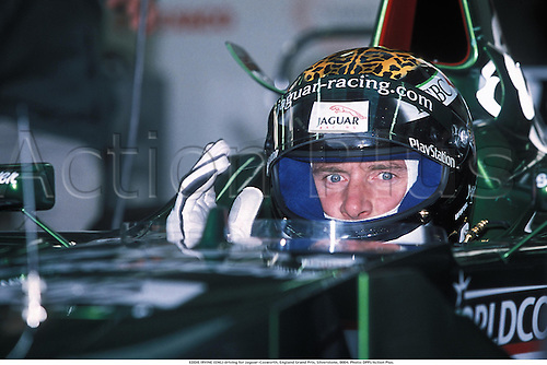 EDDIE IRVINE (ENG) driving for Jaguar-Cosworth, England Grand Prix, Silverstone, 0004. Photo:  Action Plus....2000.formula one f1.driver drivers.motor sport.motorsport.motorsports.racing car cars.helmet helmets.portrait portraits GP