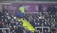 Lincoln City manager Danny Cowley (blue coat, left) watches the game from the stand after being sent off by referee Ross Joyce<br /> <br /> Photographer Chris Vaughan/CameraSport<br /> <br /> The EFL Sky Bet League Two - Lincoln City v Notts County - Saturday 13th January 2018 - Sincil Bank - Lincoln<br /> <br /> World Copyright &copy; 2018 CameraSport. All rights reserved. 43 Linden Ave. Countesthorpe. Leicester. England. LE8 5PG - Tel: +44 (0) 116 277 4147 - admin@camerasport.com - www.camerasport.com