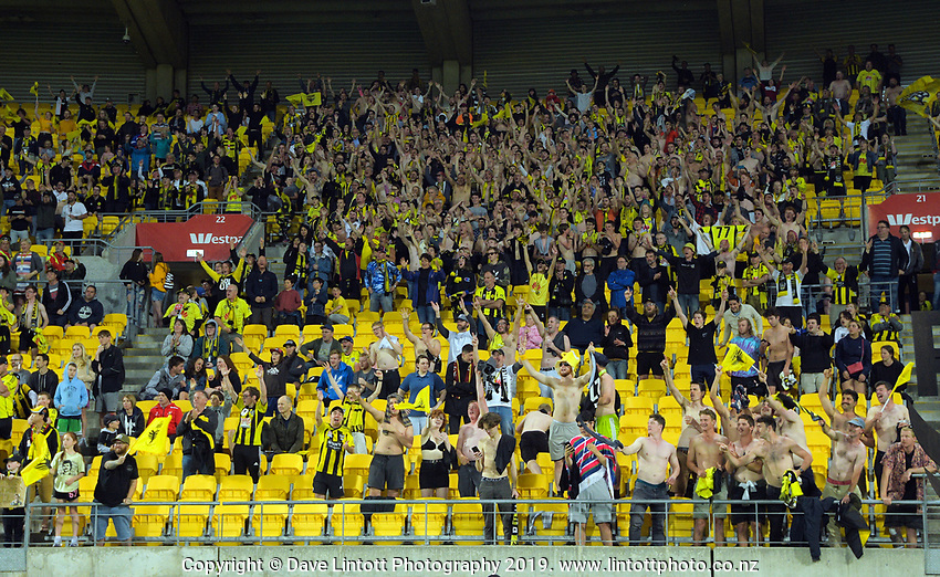 Yellow Fever get their shirts off to celebrate the 2-1 victory at the end of the A-League football match between Wellington Phoenix and Brisbane Roar at Westpac Stadium in Wellington, New Zealand on Saturday, 23 November 2019. Photo: Dave Lintott / lintottphoto.co.nz