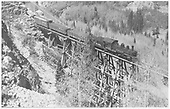 Engineer's-side view of D&amp;RGW K-27 #455 crossing RGS Bridge 46-D northbound with 13 cars.<br /> RGS  Ophir, CO  Taken by Kindig, Richard H. - 6/7/1951
