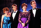 From left to right: Sally Dunbar Atwater, Lee Atwater, Chairman of the Republican National Committee, Laura Bush, and campaign advisor and businessman George W. Bush attend an Inaugural Ball celebrating the Inauguration of George H.W. Bush as the 41st President of the United States on Inauguration Day, January 20, 1989 in Washington, DC.<br /> Credit: Pam Price / Pool via CNP