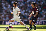 Isco of Real Madrid runs past Dani Garcia of SD Eibar during their La Liga match between Real Madrid CF and SD Eibar at the Santiago Bernabéu Stadium on 02 October 2016 in Madrid, Spain. Photo by Diego Gonzalez Souto / Power Sport Images