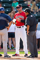 Hickory Crawdads manager Corey Ragsdale (24) meets at hoe plate with Asheville Tourists manager Fred Ocasio (28) prior to their South Atlantic League game at L.P. Frans Stadium on April 13, 2014 in Hickory, North Carolina.  The Tourists defeated the Crawdads 5-4.  (Brian Westerholt/Four Seam Images)
