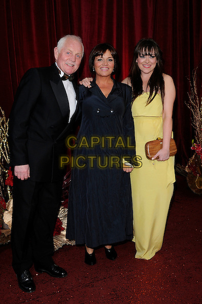 CHRISTOPHER CHITTELL, LESLEY DUNLOP & SIAN REECE WILLIAMS .Attending The British Soap Awards 2010, The London Television Centre, London, England, UK, 8th May 2010 .arrivals full length  black tuxedo bow tie tux dress yellow long maxi .CAP/CAN.©Can Nguyen/Capital Pictures.