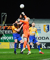 Lincoln City's Michael Bostwick vies for possession with Mansfield Town's Matt Preston, left, and Mansfield Town's Conrad Logan<br /> <br /> Photographer Chris Vaughan/CameraSport<br /> <br /> The EFL Sky Bet League Two - Mansfield Town v Lincoln City - Monday 18th March 2019 - Field Mill - Mansfield<br /> <br /> World Copyright © 2019 CameraSport. All rights reserved. 43 Linden Ave. Countesthorpe. Leicester. England. LE8 5PG - Tel: +44 (0) 116 277 4147 - admin@camerasport.com - www.camerasport.com