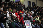 Fans react during a local competition of basketball between Khadamat al-Burij club and Khadamat al-Maghazi,  at Saad Sayel Stadium, in Gaza City on January 17, 2019. Photo by Mahmoud Ajjour