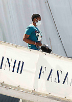Operazione Mare Nostrum , immigrati in scendono al porto di Napoli dalla nave Virginio Fasan, impiegata nell operazione Mare Nostrum. <br /> <br /> Migrants  disembark in Naples Harbour  from the ship &quot;Virginio Fasan&quot; of the Italian navy.<br /> The   vessel involved in search-and-rescue operations the ship is engaged in the rescue operation &quot;Mare Nostrum&quot; in the Mediterranean Sea