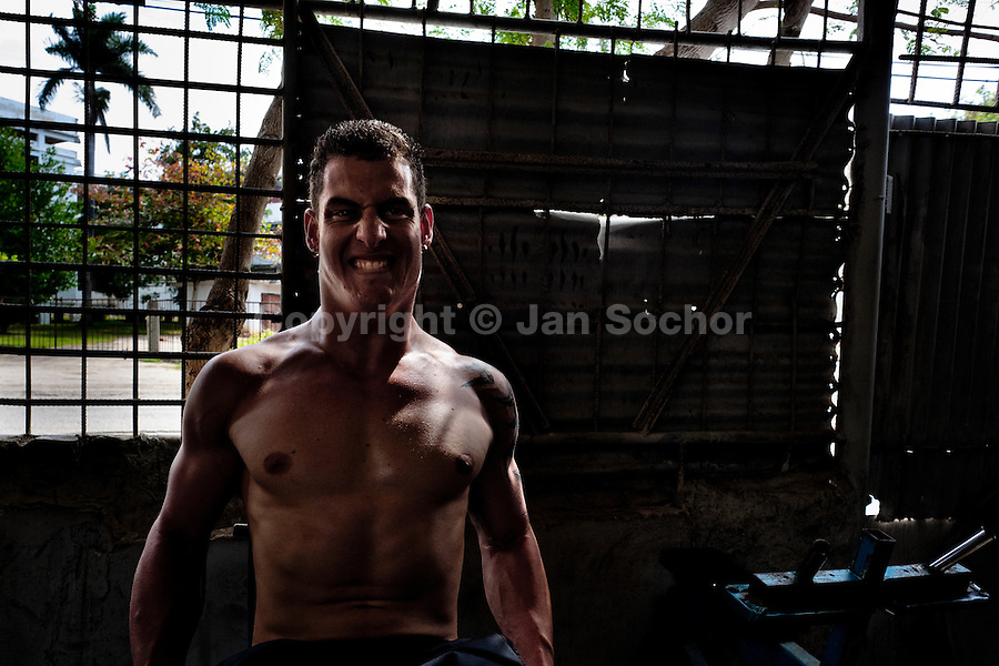 A young Cuban man works out at a bodybuilding gym in Alamar, a public housing complex in the Eastern Havana, Cuba, 9 February 2011.