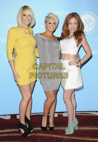Atomic Kitten - Liz McClarnon, Kerry Katona, Natasha Hamilton<br /> Arqiva Commercial Radio Awards at the Park Plaza, Westminster Bridge, London, England.<br /> July 3th 2013<br /> full length yellow grey gray white dress top cropped skirt midriff hand on hip black shoes turquoise sandals band group<br /> CAP/CAN<br /> &copy;Can Nguyen/Capital Pictures