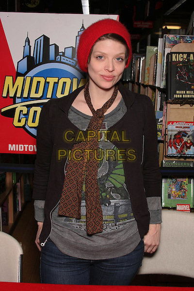 """AMBER BENSON.at the Book Signing for """"Cat's Claw"""" at Midtown Comics Times Square, New York, NY, USA, .February 27th, 2010..half length brown scarf  black grey gray top red hat beanie jacket .CAP/LNC/TOM.©LNC/Capital Pictures"""