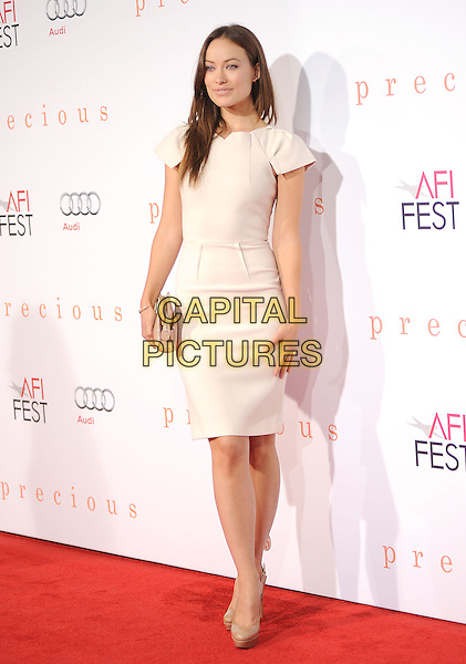 "OLIVIA WILDE.The 2009 AFI Fest Screening of ""Precious"" held at The Grauman's Chinese Theatre in Hollywood, California, USA..November 1st, 2009.full length white cream dress beige shoes clutch bag.CAP/RKE/DVS.©DVS/RockinExposures/Capital Pictures"