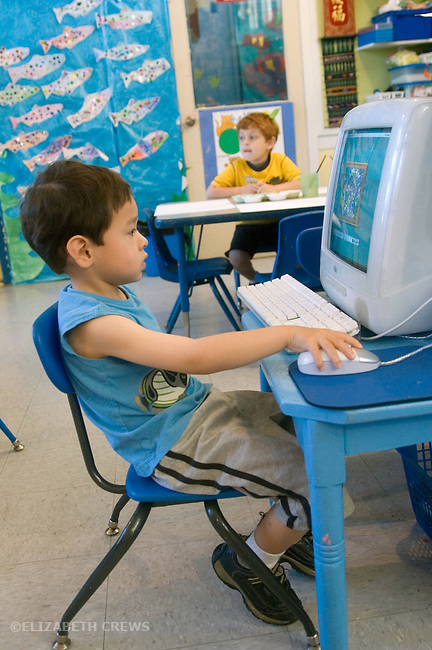 Berkeley CA  Preschool boy doing learning game on computer in class.