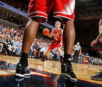 North Carolina State guard Tyler Lewis (12) handles the ball during the game against Virginia Saturday in Charlottesville, VA. Virginia defeated NC State 58-55.
