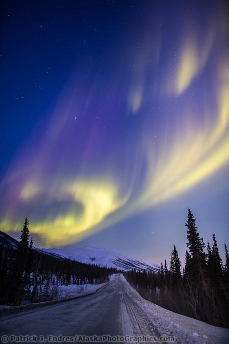 The Aurora borealis over the James Dalton Highway in the Brooks Range of Alaska.