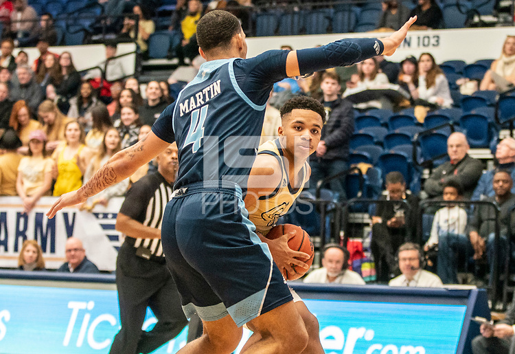 WASHINGTON, DC - FEBRUARY 8: Tyrese Martin #4 of Rhode Island defends against Jameer Nelson Jr. #12 of George Washington during a game between Rhode Island and George Washington at Charles E Smith Center on February 8, 2020 in Washington, DC.