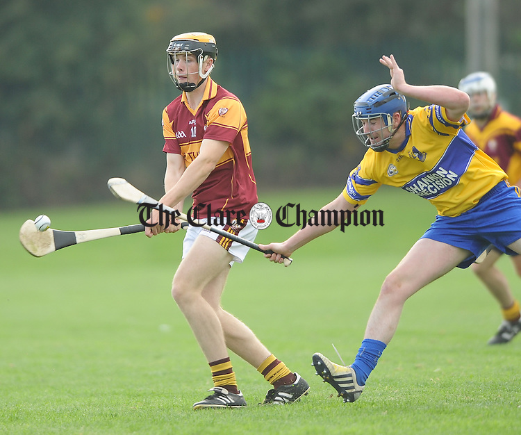Colin Corbett of Tulla in action against Conor Murphy of Sixmilebridge during the Junior B hurling final at Clarecastle. Photograph by John Kelly