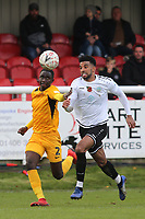 Southend United's Elvis Bwomono and Oscar Gobern of Dover challenge for the ball during Dover Athletic vs Southend United, Emirates FA Cup Football at the Crabble Athletic Ground on 10th November 2019