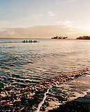 USA, Hawaii, The Big Island, Hilo, a team of women row an Outrigger Canoe in Hilo Bay