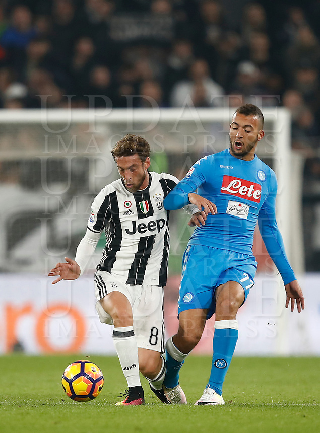 Calcio, Serie A: Juventus Stadium. Torino, Juventus Stadium, 29 ottobre 2016.<br /> Juventus' Claudio Marchisio, left, is challenged by Napoli's Omar El Kaddouri during the Italian Serie A football match between Juventus and Napoli at Turin's Juventus Stadium, 29 October 2016. Juventus won 2-1.<br /> UPDATE IMAGES PRESS/Isabella Bonotto