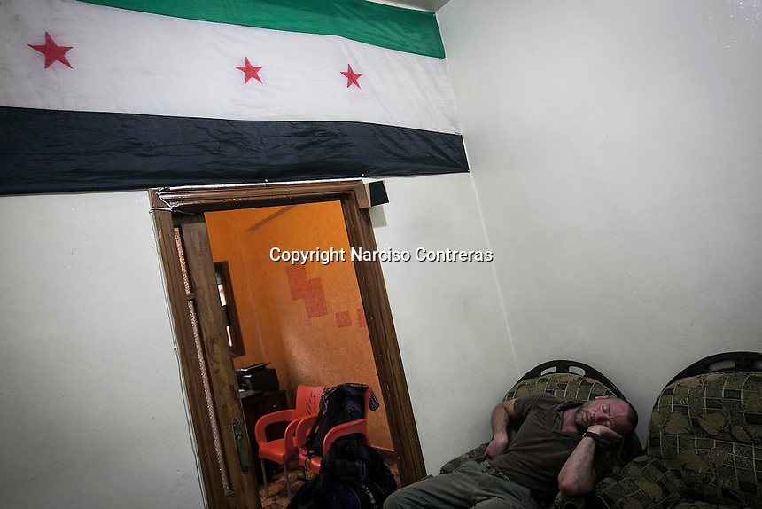 Dimitri Bontinck, a 39 years old belgium sleeps at the office of an opposition group as he awaits for a contact's answer, whom is looking the traces of Jejoen, Dimitri's son, a youth belgium who has turned himself into a Islamic fighter who is battling Syrian government army beside radical Muslim groups at the northern of Syria.