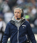 Seattle Seahawks Head Coach Pete Carroll, looks at the replay screne during their game against the St. Louis Rams at CenturyLink Field in Seattle, Washington on December 30, 2012.   The Seahawks came from behind to beat the Rams 20-13.    © 2102.  Jim Bryant Photo. All Rights Reserved.