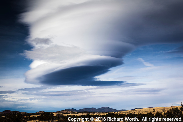 An enormous lenticular cloud hovers over the high desert off Interstate 40 in Arizona on a winter afternoon.