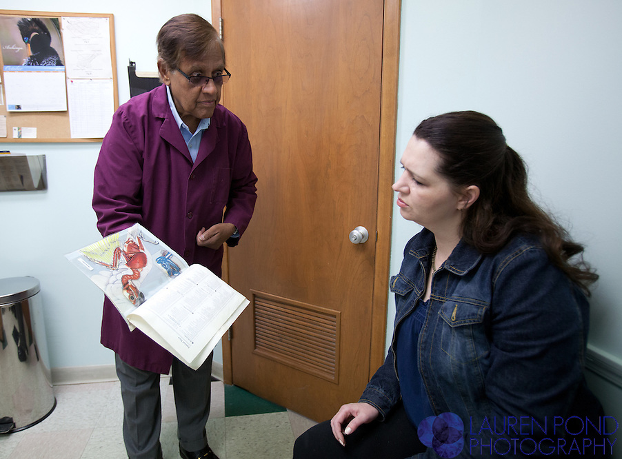 Dr. Ram Mohan discusses bird health with client Kim Moore, of Groveport, Ohio.