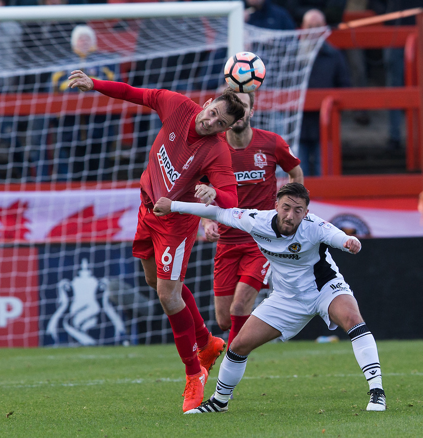Paul Marshall of Alfreton Town heads the ball under pressure from Josh Sheehan of Newport County<br /> <br /> Photographer James Williamson/CameraSport<br /> <br /> The Emirates FA Cup First Round - Alfreton Town v Newport County - Sunday 6th November 2016 - North Street - Alfreton<br />  <br /> World Copyright &copy; 2016 CameraSport. All rights reserved. 43 Linden Ave. Countesthorpe. Leicester. England. LE8 5PG - Tel: +44 (0) 116 277 4147 - admin@camerasport.com - www.camerasport.com