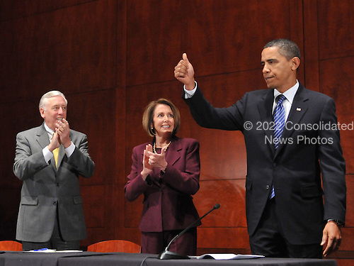 "United States President Barack Obama gives a ""thumbs-up"" before delivering remarks to the House Democratic Caucus retreat at the U.S. Capitol Visitors Center in Washington, D.C. on Thursday, January 14, 2010. From left to right: U.S. House Majority Leader Steny Hoyer (Democrat of Maryland); U.S. House Speaker Nancy Pelosi (Democrat of California); President Obama..Credit: Ron Sachs / Pool via CNP"