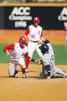 Scott Davis #12 of the Delaware State Hornets puts the tag on Steve Anderson #19 of the Georgetown Hoyas as he tries to steal second base at Gene Hooks Field on February 26, 2011 in Winston-Salem, North Carolina.  Photo by Brian Westerholt / Four Seam Images