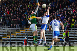 Kerrys David Moran and  Darren Hughes contest the kick out during their NFL clash in Fitzgerald Stadium on Sunday
