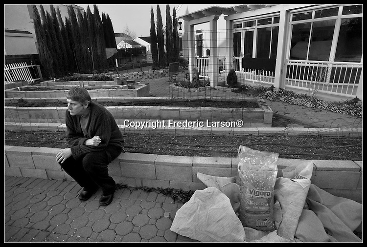 Howard McNeece sits alone in his garden as he and his partner Chuck Karafotas are forced to sell their home due to hard economic times.