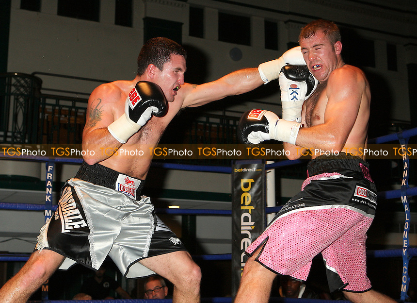 Scott Woolford (Ramsgate, pink/black shorts) loses to Tom Glover (Colchester, silver/black shorts) in a Welterweight boxing contest for the Southern Area Title at York Hall Bethnal Green, promoted by Frank Maloney / FTM Sports - 15/11/08 - MANDATORY CREDIT: Gavin Ellis/TGSPHOTO - Self billing applies where appropriate - 0845 094 6026 - contact@tgsphoto.co.uk - NO UNPAID USE.