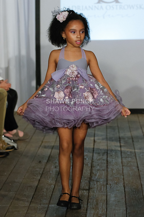 Child model walks runway in an outfit from the Adrianna Ostrowska fashion show, during the KidFash Magazine runway show in Brooklyn, New York on Nov 4, 2017.