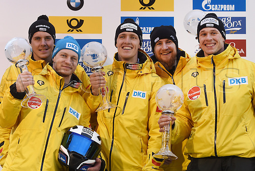 28.02.2016. Koenigssee, Germany.  German bobsled pilot Francesco Friedrich  (2.f.L.) holds up the World Cup victory trophy as he stands with his pushers Jannis Baecker (L), Thorsten Margis (C-R), Martin Grothkopp and Candy Bauer at the Bobsled  World Cup in Koenigssee, Germany, 28 February 2016. Friedrich won third place in the race and second place overall at the World Cup.