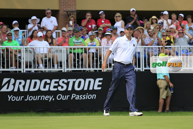 Matt KUCHAR (USA) sinks his putt on the 9th green during Friday's Round 2 of the WGC Bridgestone Invitational, held at the Firestone Country Club, Akron, Ohio.: Picture Eoin Clarke, www.golffile.ie: 1st August 2014