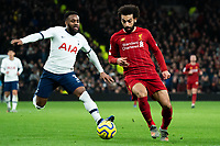 Tottenham's Japhet Tanganga battles for possession with Liverpool's Mohamed Salah <br /> <br /> Photographer Stephanie Meek/CameraSport<br /> <br /> The Premier League - Tottenham Hotspur v Liverpool - Saturday 11th January 2020 - Tottenham Hotspur Stadium - London<br /> <br /> World Copyright © 2020 CameraSport. All rights reserved. 43 Linden Ave. Countesthorpe. Leicester. England. LE8 5PG - Tel: +44 (0) 116 277 4147 - admin@camerasport.com - www.camerasport.com