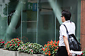 A pedestrian walks past the LOTTE Japan headquarters in Shinjuku on July 29, 2015, Tokyo, Japan. Shares in Lotte group companies jumped up on Wednesday as investors expect founding family members to try to increase their holdings. On Tuesday the board of Lotte Holdings had sacked 92-year-old founder Shin Kyuk-ho from his position as co-CEO. This led to speculation that other family members would try to compete for control of the Korean conglomerate. (Photo by Rodrigo Reyes Marin/AFLO)