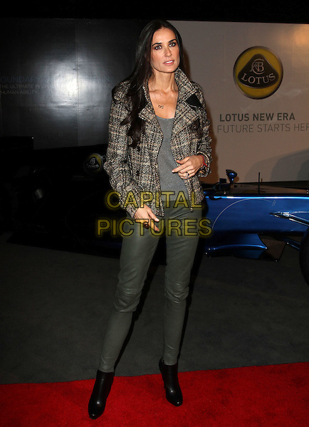 DEMI MOORE.U.S. Launch Event for New Lotus Carst held at A Private Residence, Los Angeles, CA, USA, .12th November 2010..full length grey gray top t-shirt tweed wool brown plaid jacket tartan green khaki leather pants trousers black boots ankle .CAP/ADM/KB.©Kevan Brooks/AdMedia/Capital Pictures.