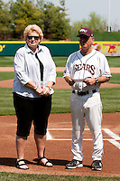 Coach Keith Guttin (2) presents a check to the director of Greene County Park and Recreation prior to a game against the Wichita State Shockers on April 9, 2011 at Hammons Field in Springfield, Missouri.  Photo By David Welker/Four Seam Images