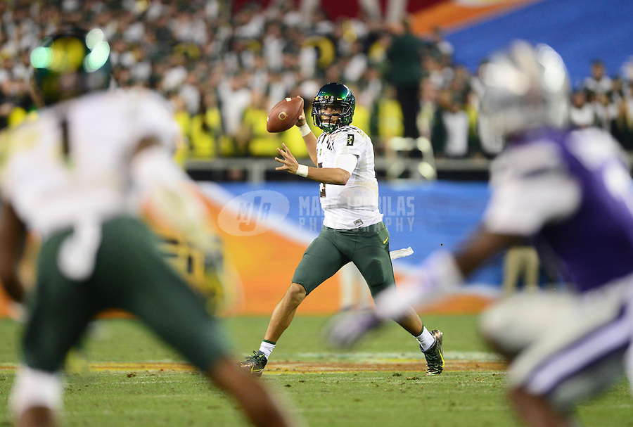 Jan. 3, 2013; Glendale, AZ, USA: Oregon Ducks quarterback Marcus Mariota (8) throws a pass in the third quarter against the Kansas State Wildcats during the 2013 Fiesta Bowl at University of Phoenix Stadium. Oregon defeated Kansas State 35-17. Mandatory Credit: Mark J. Rebilas-