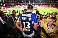 Picture by Alex Whitehead/SWpix.com - 10/10/2015 - Rugby League - First Utility Super League Grand Final - Leeds Rhinos v Wigan Warriors - Old Trafford, Manchester, England - Leeds captain Kevin Sinfield celebrates with the fans.