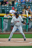 Guillermo Heredia (14) of the Tacoma Rainiers at bat against the Salt Lake Bees in Pacific Coast League action at Smith's Ballpark on July 23, 2016 in Salt Lake City, Utah. The Rainiers defeated the Bees 4-1. (Stephen Smith/Four Seam Images)